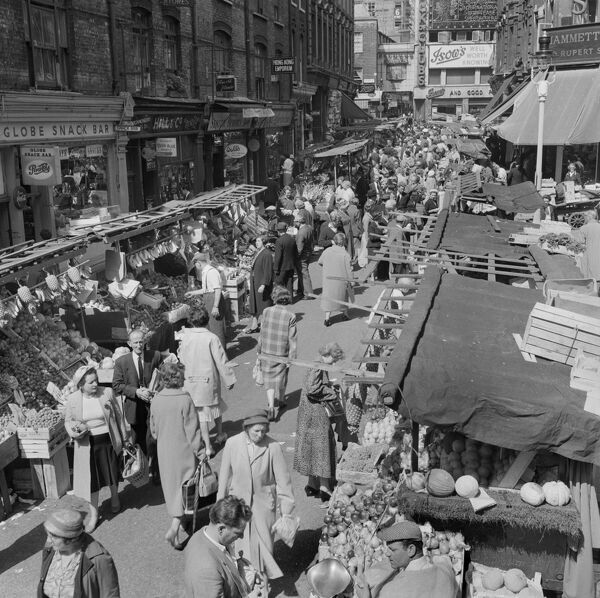 Rupert Street, Soho, London. Elevated view looking north along Rupert Street, showing a bustling Berwick Street Market. Photographed by John Gay, mid-1950s