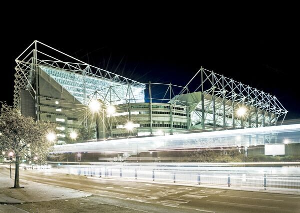 ST JAMES PARK, Newcastle-upon-Tyne. Home of Newcastle United Football Club. The stark lighting helps the stadium to stand out on the Newcastle skyline. Played on Tyne and Wear