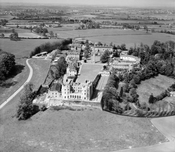 The Stoke Park Colony (Stoke Park Hospital), Stoke Gifford, near Bristol, South Gloucestershire, 13th May 1947. The, now yellow, Dower House, situated on the balustraded terrace, remains a prominent landmark. Aerofilms Collection