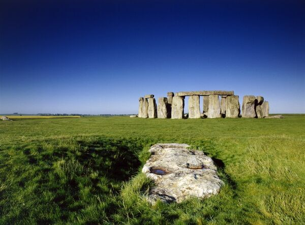 STONEHENGE, Wiltshire. View from the North East with the Slaughter Stone in the foreground