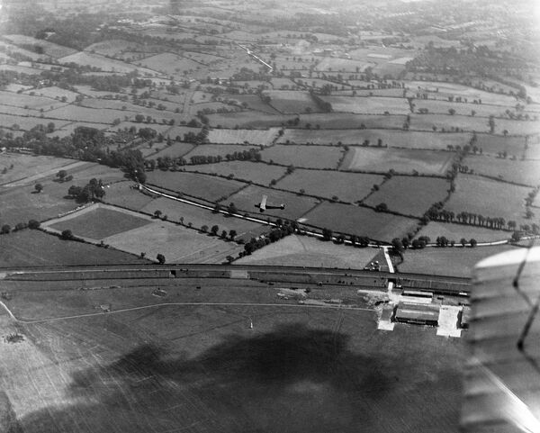 LONDON AERODROME, Hendon. From the first ever Aerofilms flight taking commercial aerial photography in July 1919. Shows the area around Hendon and another aircraft in flight. Aerofilms Collection (see Links)