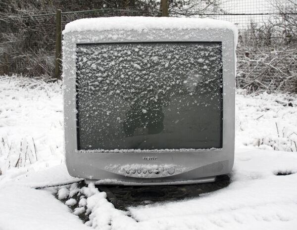 Snow covered computer monitor