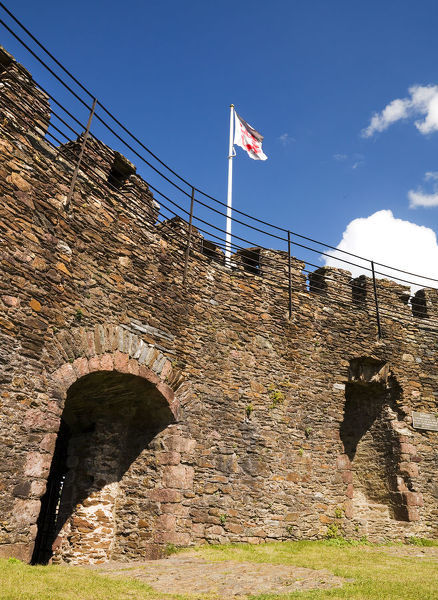 TOTNES CASTLE, Devon. Castle wall interior with English Heritage flag