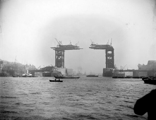 TOWER BRIDGE, London. The bridge under construction around 1889. This picture was taken from the River Thames with shipping in the foreground. Construction of the bridge began in 1881 and was completed by 1894 to the designs of Sir Horace Jones