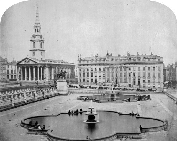 TRAFALGAR SQUARE, Westminster, London. A view looking east across Trafalgar Square with the fountains in the foreground and the equestrian statue of George IV, Morley's Hotel (now South Africa House) and the church of St Martin-in-the-Fields beyond