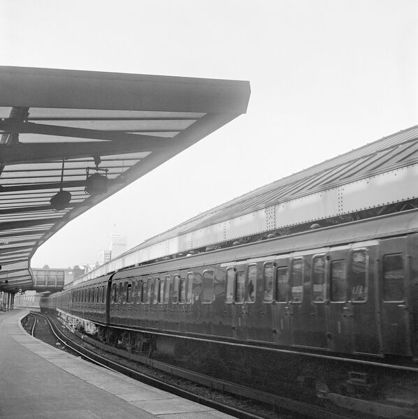 VICTORIA STREET STATION, London. A train passing beside a deserted outdoor section of platform at Victoria Station. John Gay. Date range: 1960-1972