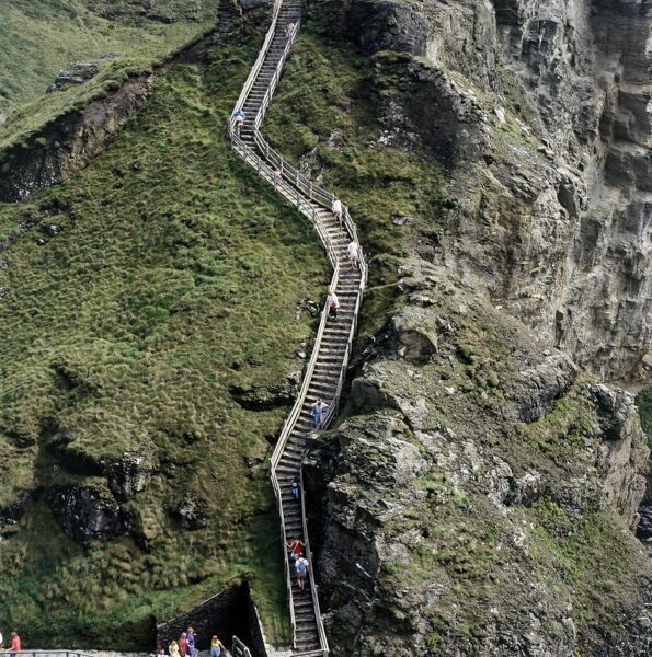 TINTAGEL CASTLE, Cornwall. Distant view of visitors on the walkway stairs
