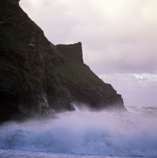 TINTAGEL CASTLE, Cornwall. The sea crashing against the cliff