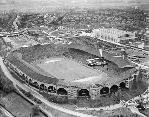 WEMBLEY STADIUM, London. An aerial view of the Wembley Cup Final 1935. A Metropolitan Police Autogyro (Cierva C-30) monitors security at the match between Sheffield Wednesday and West Bromwich Albion, which Sheffield Wednesday won 4-2. Aerofilms Collection