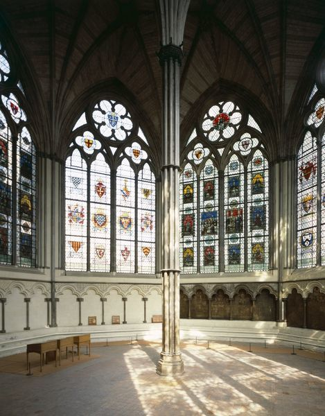 WESTMINSTER ABBEY CHAPTER HOUSE, London. Interior view showing stained glass windows