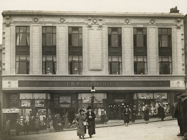 F W Woolworth And Company Limited, Spiceal Street, Birmingham. Exterior view of the shop front, with two women walking towards the camera in the foreground, 1921-35