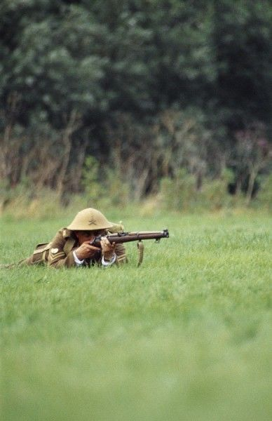 FESTIVAL OF HISTORY, Stoneleigh Park, Warwickshire. World War One soldier aiming rifle. 2004 re-enactment event