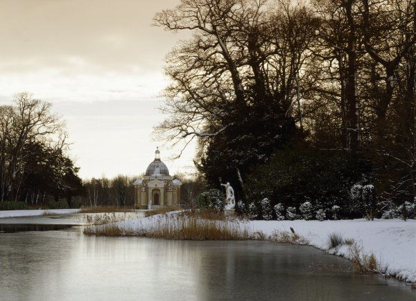 WREST PARK HOUSE AND GARDENS, Silsoe, Bedfordshire. View of the Long Water and the Archer Pavilion in the snow
