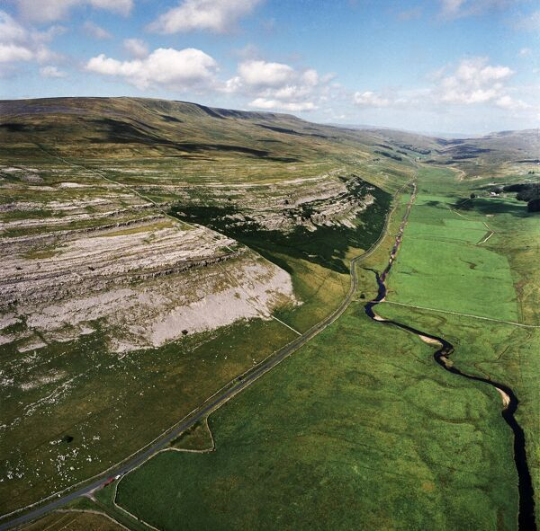 KELD HEAD SCAR, North Yorkshire. Aerial photograph of Kingsdale, near Thornton Force in the Yorkshire Dales. The cliffs reveal the Great Scar Limestone, which consist of a number of layers of limestone beds of varying thickness and hardness