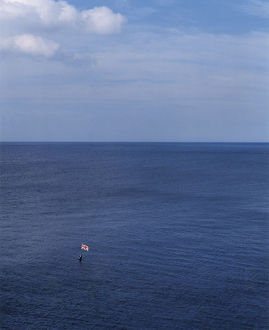 Flag, buoy, sea, sky OP13135